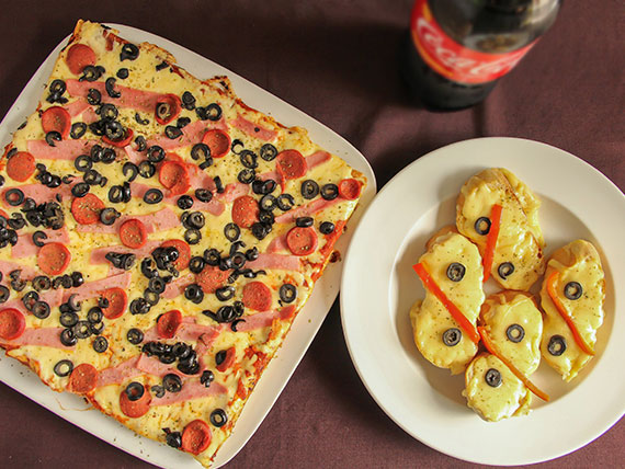Promo 10 - 1 pizza familiar + bebida de 1.5 L + 4 pan de ajo especial