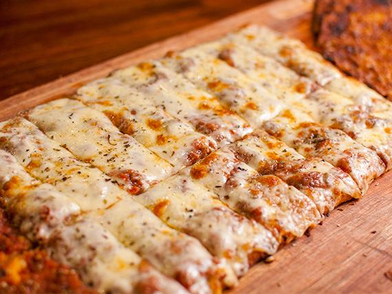 Porción pizza con muzzarella