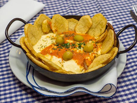 Matambrito de ternera tiernizado a la pizza con papas españolas