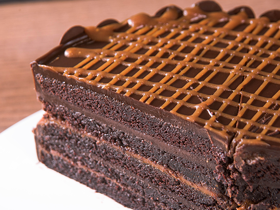 Torta chocolate manjar (porción)