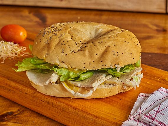 Sándwich bagel con carré de cerdo