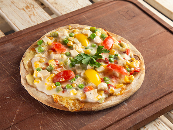 Pizza de la casa verduras al wok