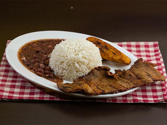 Bistec de res con arroz blanco, menestra del día, tajada + Soda