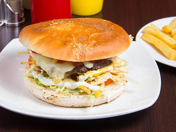 Promo 1 - Hamburguesa de carne artesanal o filet de pollo + papas fritas + bebida 250 ml