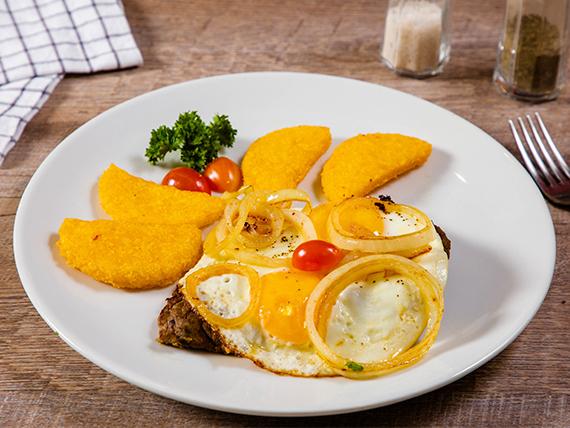Bistec de res a caballo + dos hojaldres o dos tortillas