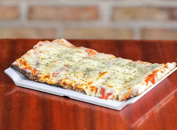 Porción pizza muzzarella