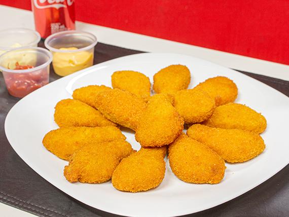 Promo - 12 nuggets de pollo a elección + papas fritas + lata de Coca Cola