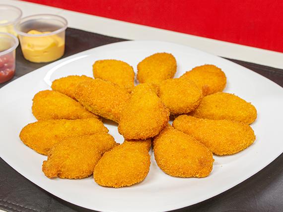 Promo - 12 nuggets de pollo a elección + papas fritas + lata de cerveza Brahma