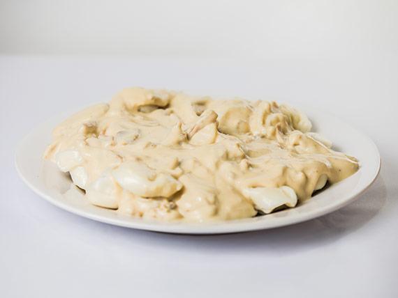 Sorrentinos, romanos o raviolones con salsa de queso y puerros para 1 persona