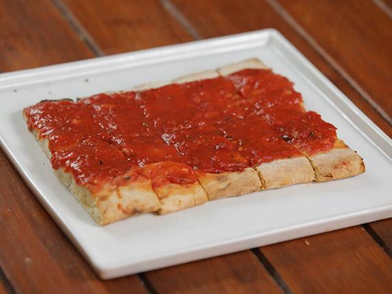 Pizza al tomate (porción)